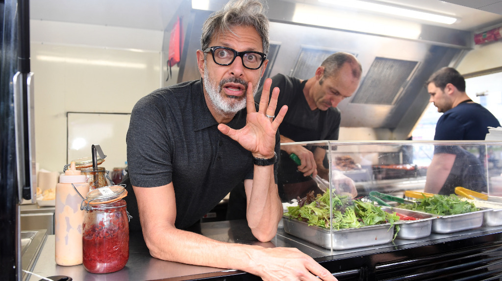 Actor Jeff Goldblum hands out sausages at food truck in Sydney