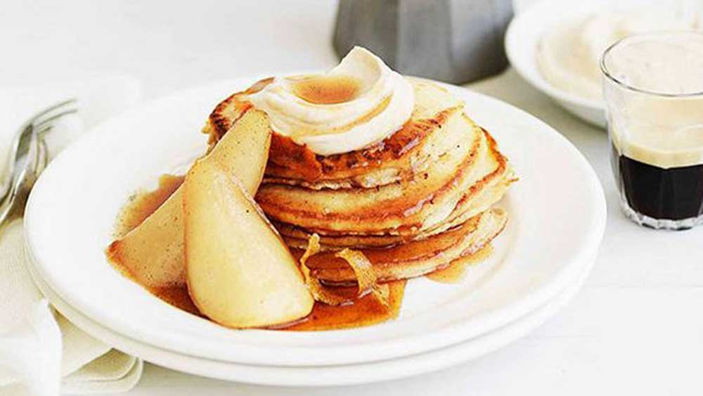 Pancakes with maple syrup and pears