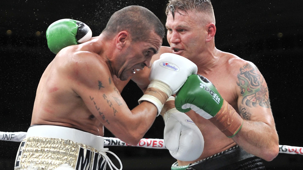 Anthony Mundine and Danny Green during their fight in Adelaide. (AAP)