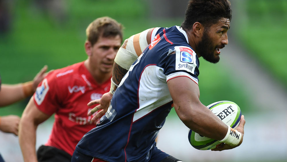 Amanaki Mafi take the ball ahead for the Rebels. (AAP)