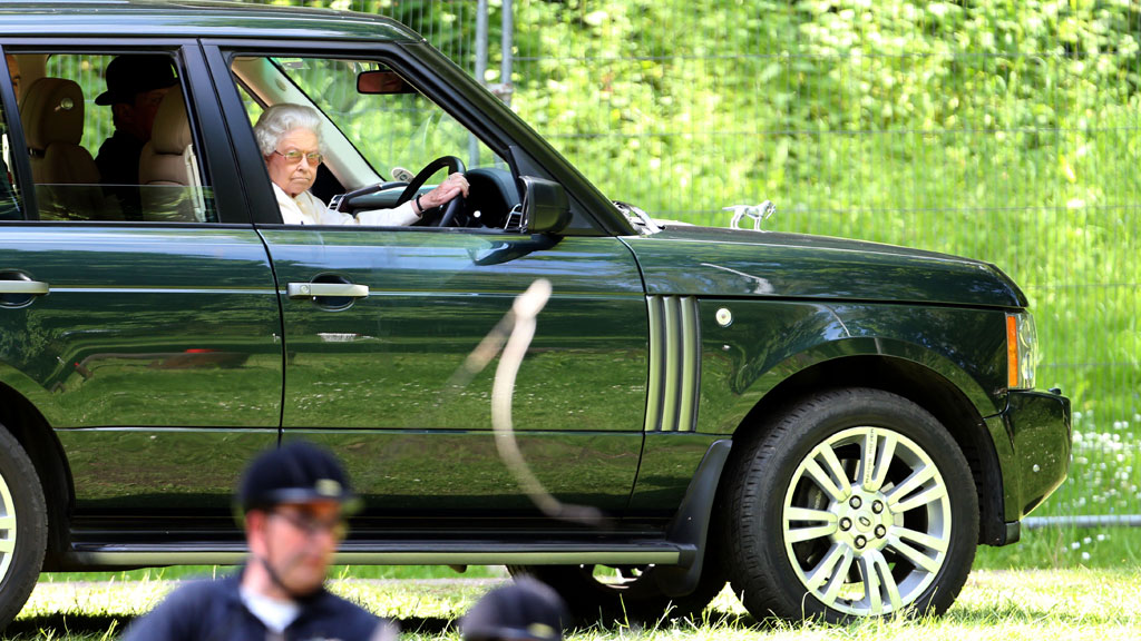 The Queen Driving Her Jaguar Home From Church Is