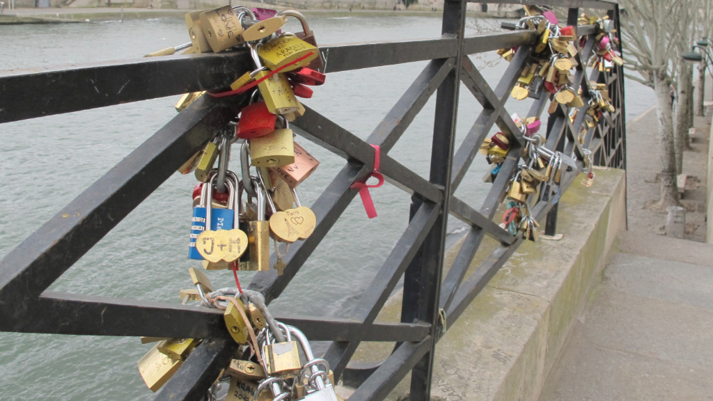 Love locks attached to a railing at Pont des Arts' pedestrian bridge in February. (AFP)