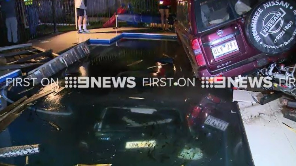 Cars plunge into Melbourne swimming pool after crash outside home