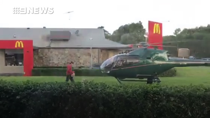 The pilot was seen taking his order back to the helicopter, before flying away. (9NEWS)