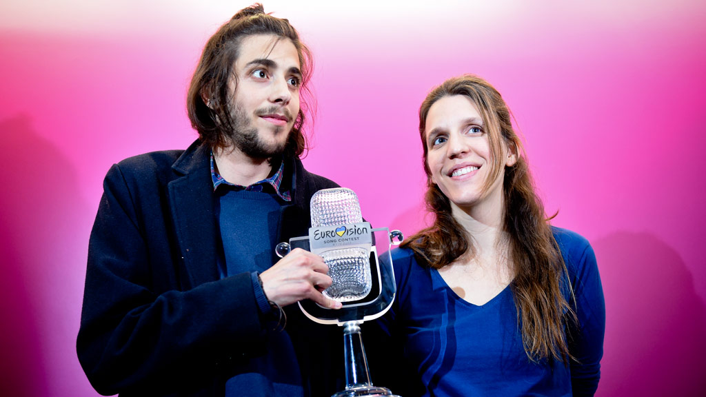 Winner of 2017 Eurovision contest Salvador Sobral accompanied by his sister Luisa Sobral pose with his trophy before a press conference upon their arrival at Humberto Delgado Lisbon's airport on May 14, 2017. (AFP)