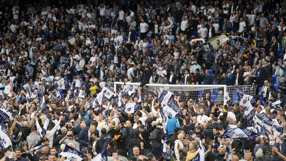 Tottenham Hotspur fans flood the field after downing Manchester United to finish second in EPL