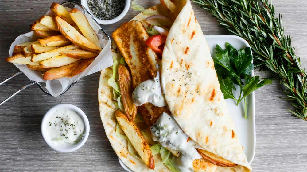 Grilled haloumi gyros with tzatziki and oven-baked herb salted fries