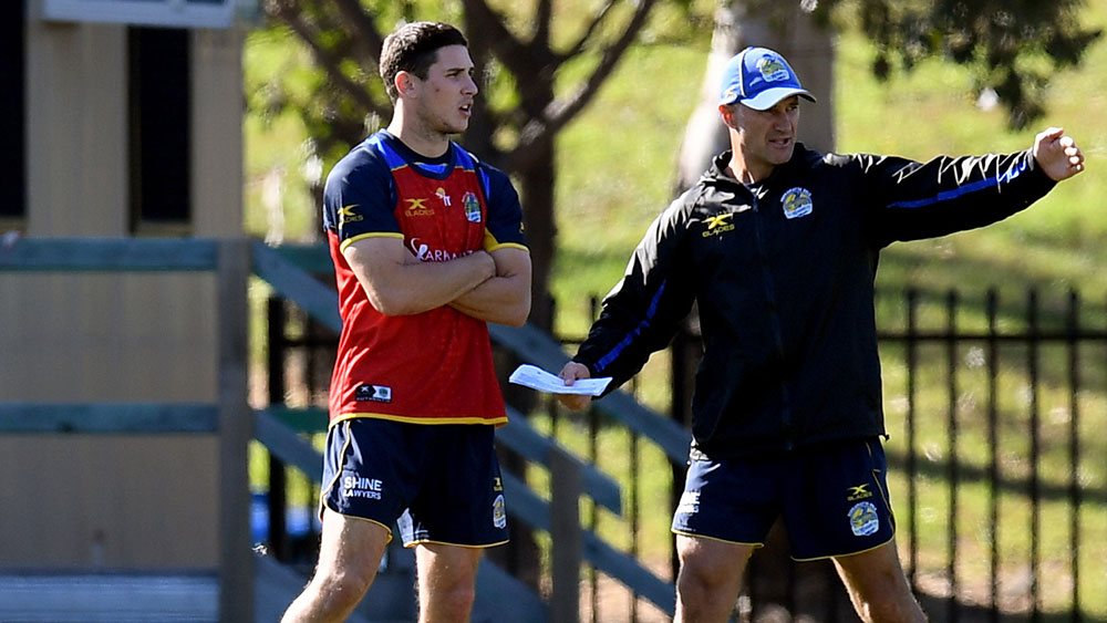Mitchell Moses with Eels coach Brad Arthur. (AAP)