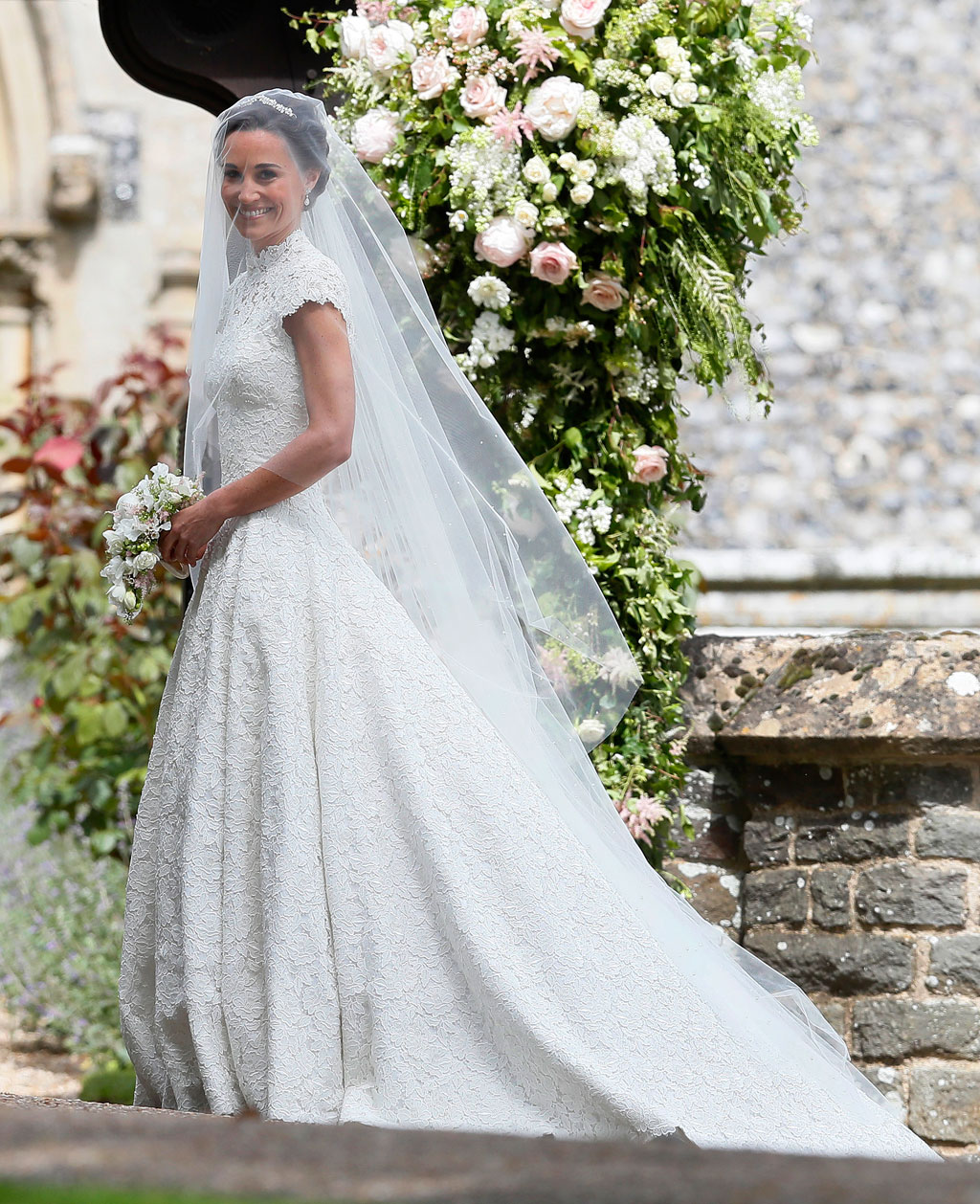 The bride wore a gown by British designer Giles Deacon. (AAP)