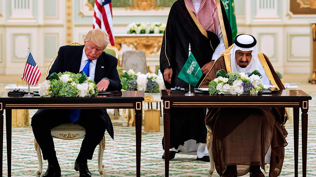 US President Donald Trump (L) and Saudi Arabia's King Salman bin Abdulaziz al-Saud attending a signing ceremony at the Saudi Royal Court in Riyadh. (AFP)