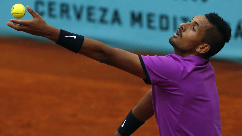 An ailing Nick Kyrgios suffered a shock loss in Lyon. (AAP)