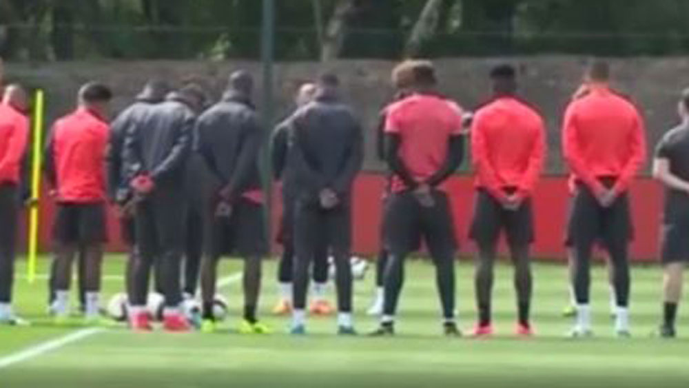 Manchester United players held a minute's silence during preparations for the Europa League final.