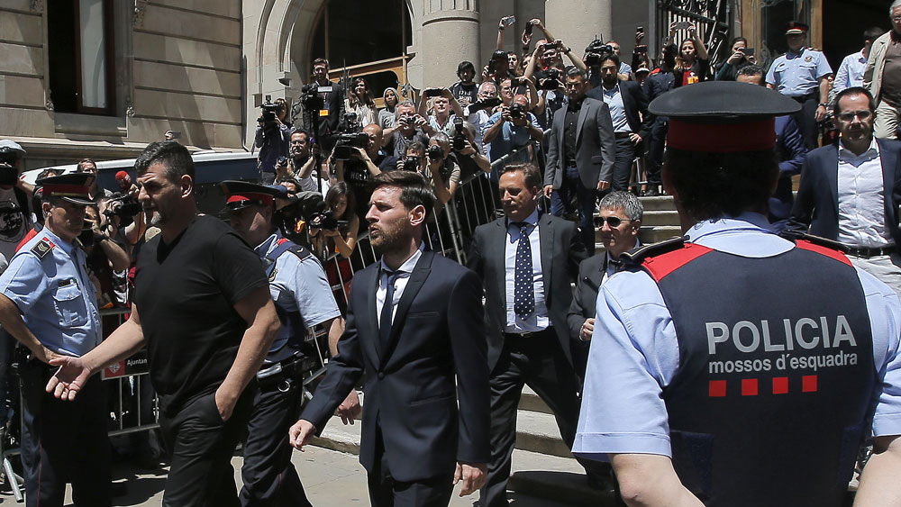 Lionel Messi leaves court after a 2016 appearance. (AAP)