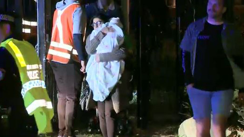 A train full of commuters was left stranded on the tracks as police surveyed the area. (9NEWS)