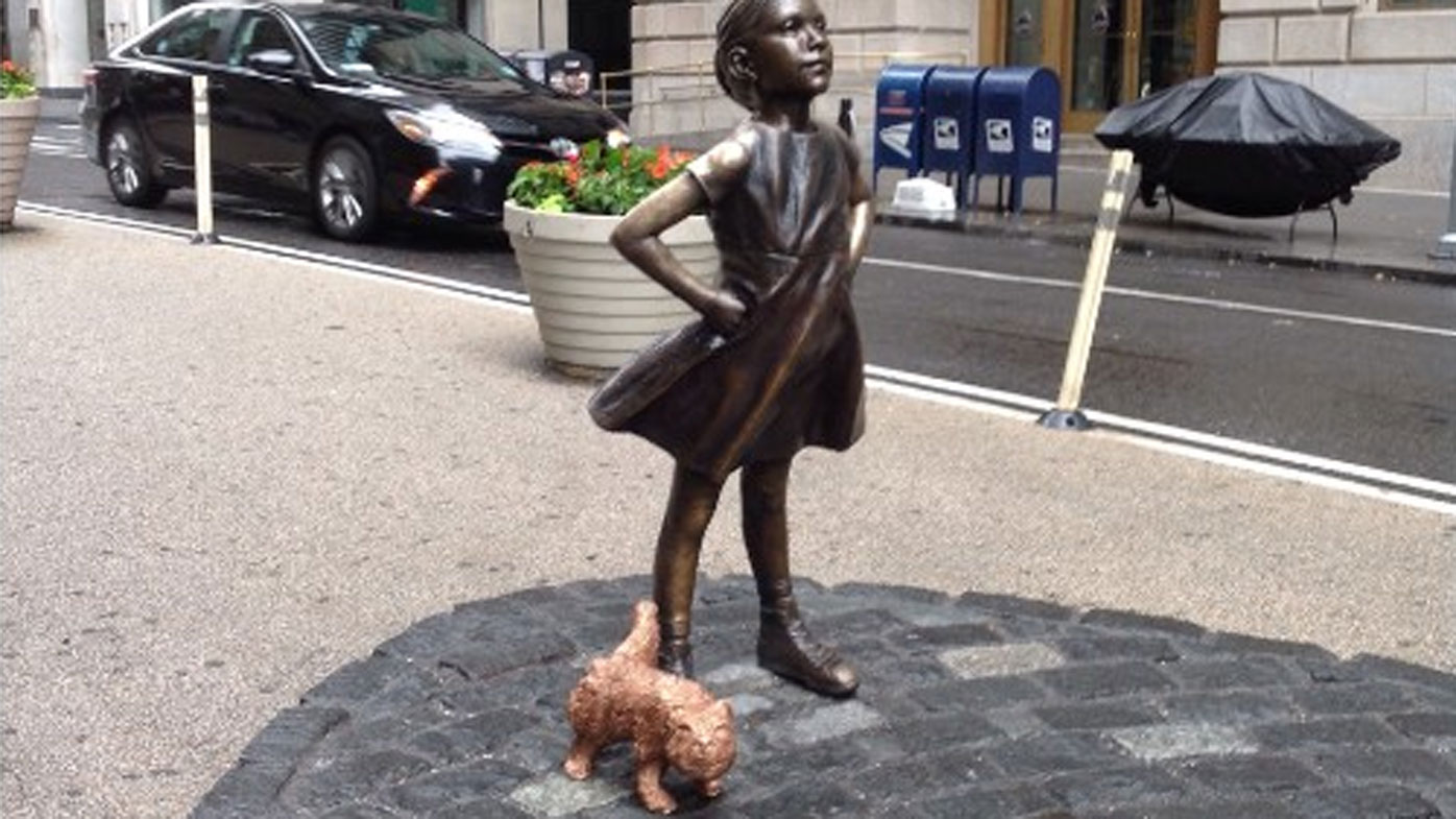 Urinating dog takes on Wall Street's Fearless Girl