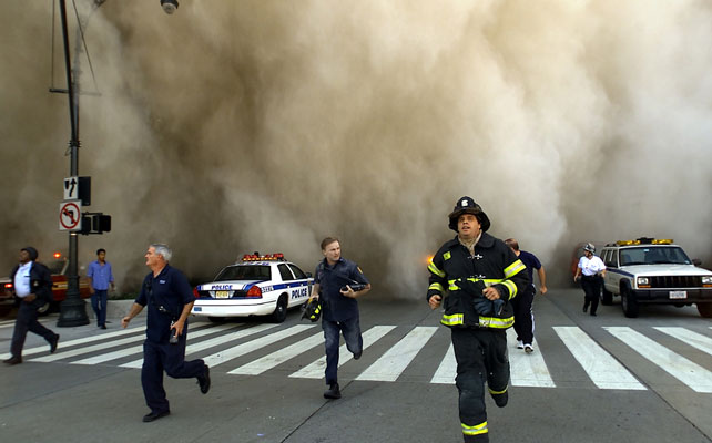 First responders fleeing a dust cloud after the collapse of the World Trade Centre. (AFP)