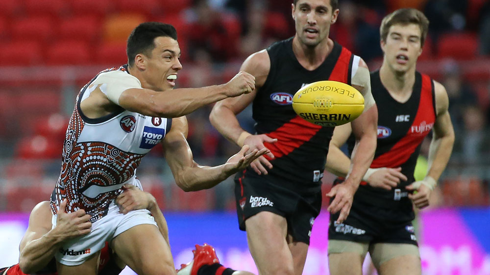 GWS Giants' Dylan Shiel gets a hand-pass away against Essendon. (AAP)