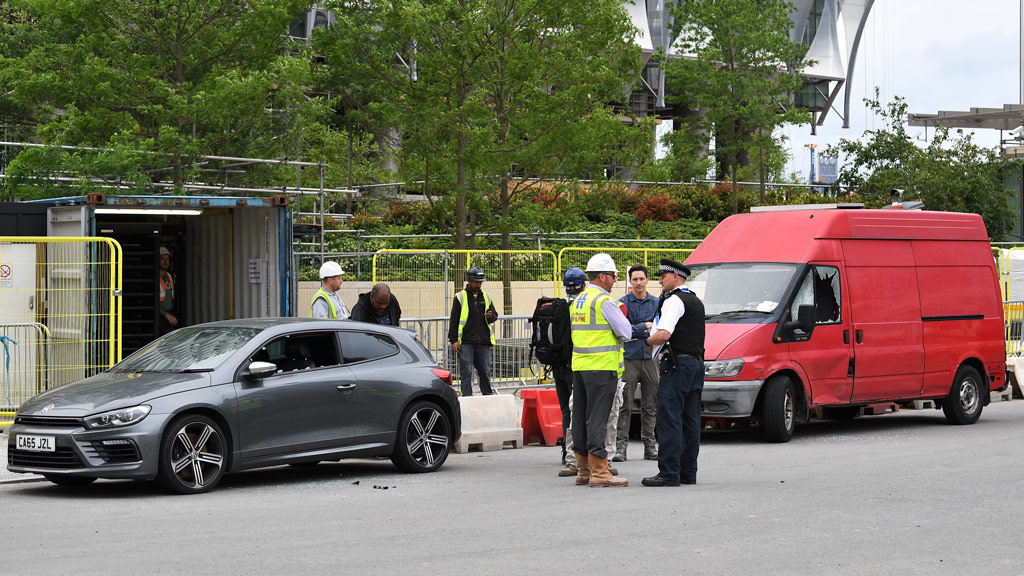 Police stand beside two vehicles in which they carried out controlled explosions near the new but still unoccupied US embassy building in south London, on June 7, 2017. (AFP)