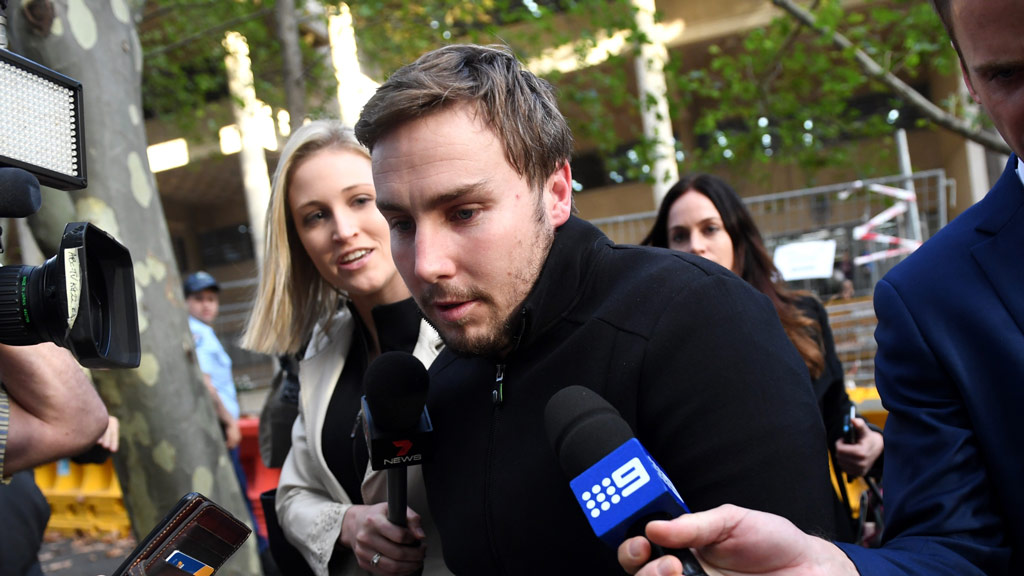 Adam Cranston (centre) leaves the Sydney Police Centre in Surry Hills in May. (AAP)
