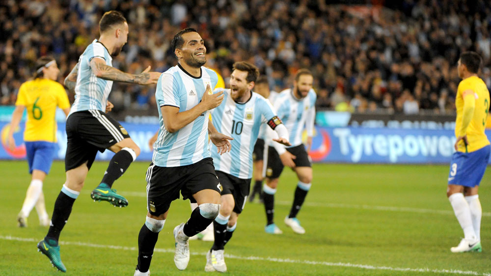 New Argentina coach aims for collective approach with Messi