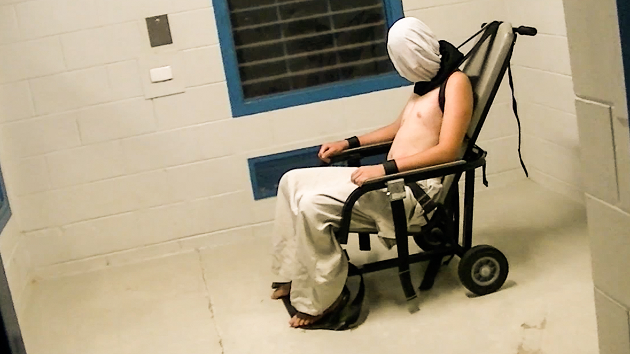 This image of Voller in a spit-hood and strapped to a restraint chair prompted the Prime Minister to order a Royal Commission into the Protection and Detention of Children in the Northern Territory. (60 Minutes)