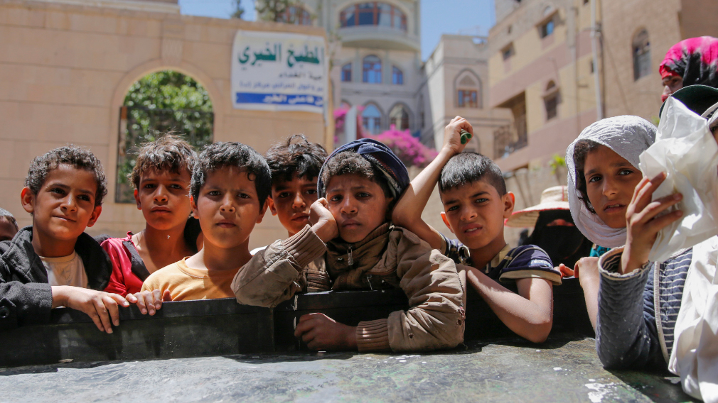 Yemeni children wait for food rations. (AFP)
