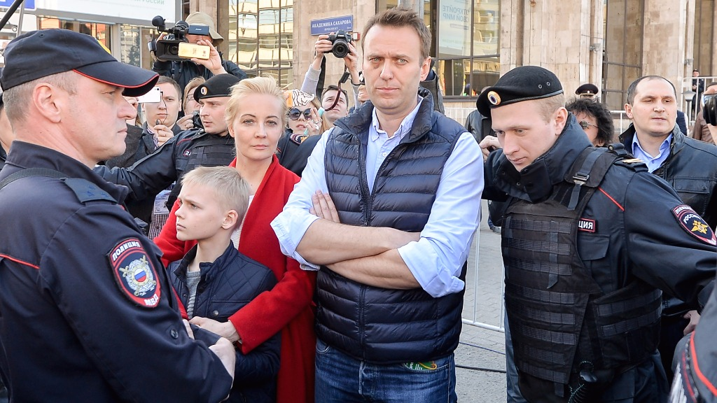 Navalny held as thousands protest Putin