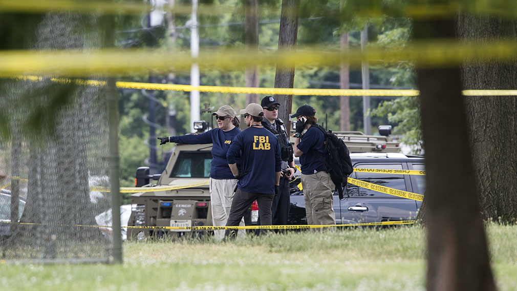 Mr Brooks said he saw the man shooting from a chain link fence behind the third base position. (AAP)