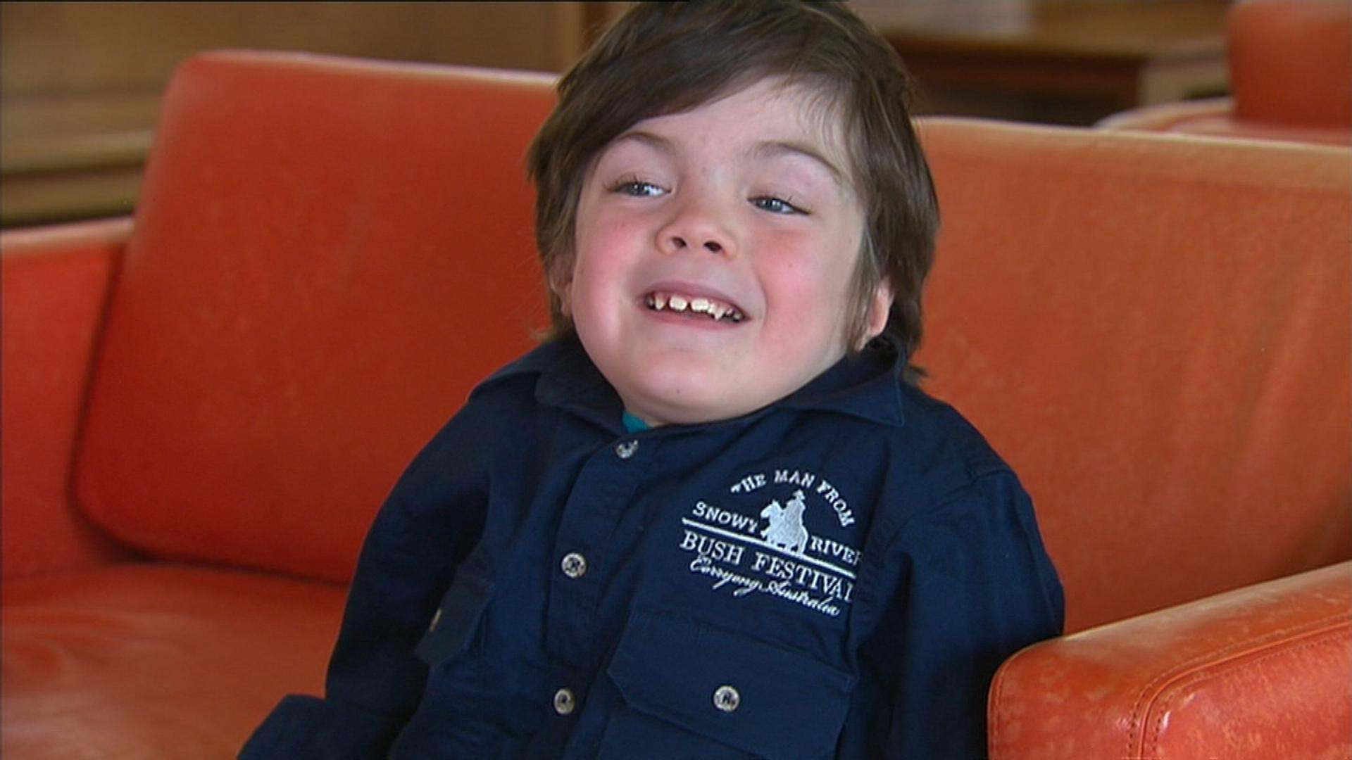 Six-year-old Beau Cosgrove was only expected to live to the age of five. (9NEWS)