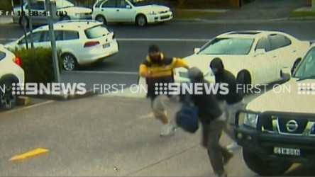Three masked offenders are on the run after threatening a man outside a Sydney shopping centre. (9NEWS)