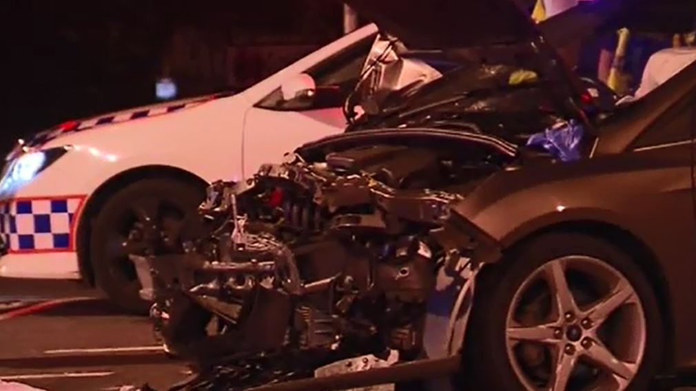 Police believe the car and motorbike collided about 6.40pm. (9NEWS)