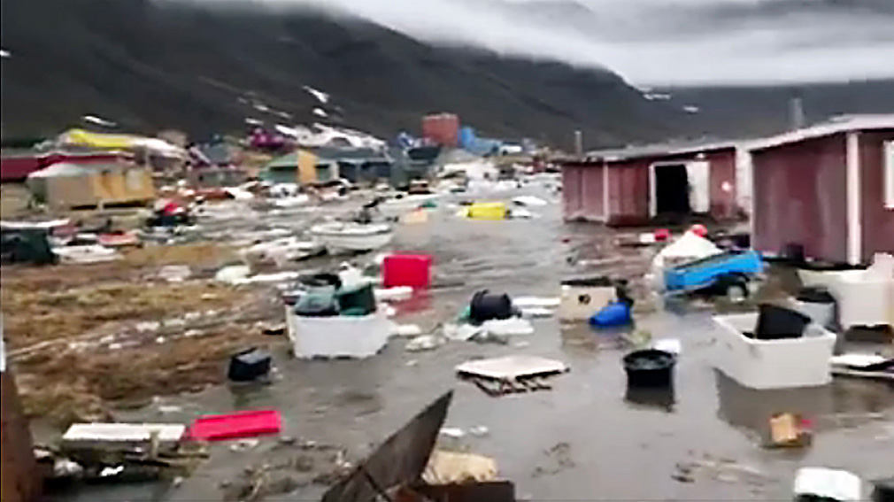 Grab taken from a video shows houses close to Nuugaatsiag, Greenland, flooded by tidal waves on June 18, 2017. (AFP)