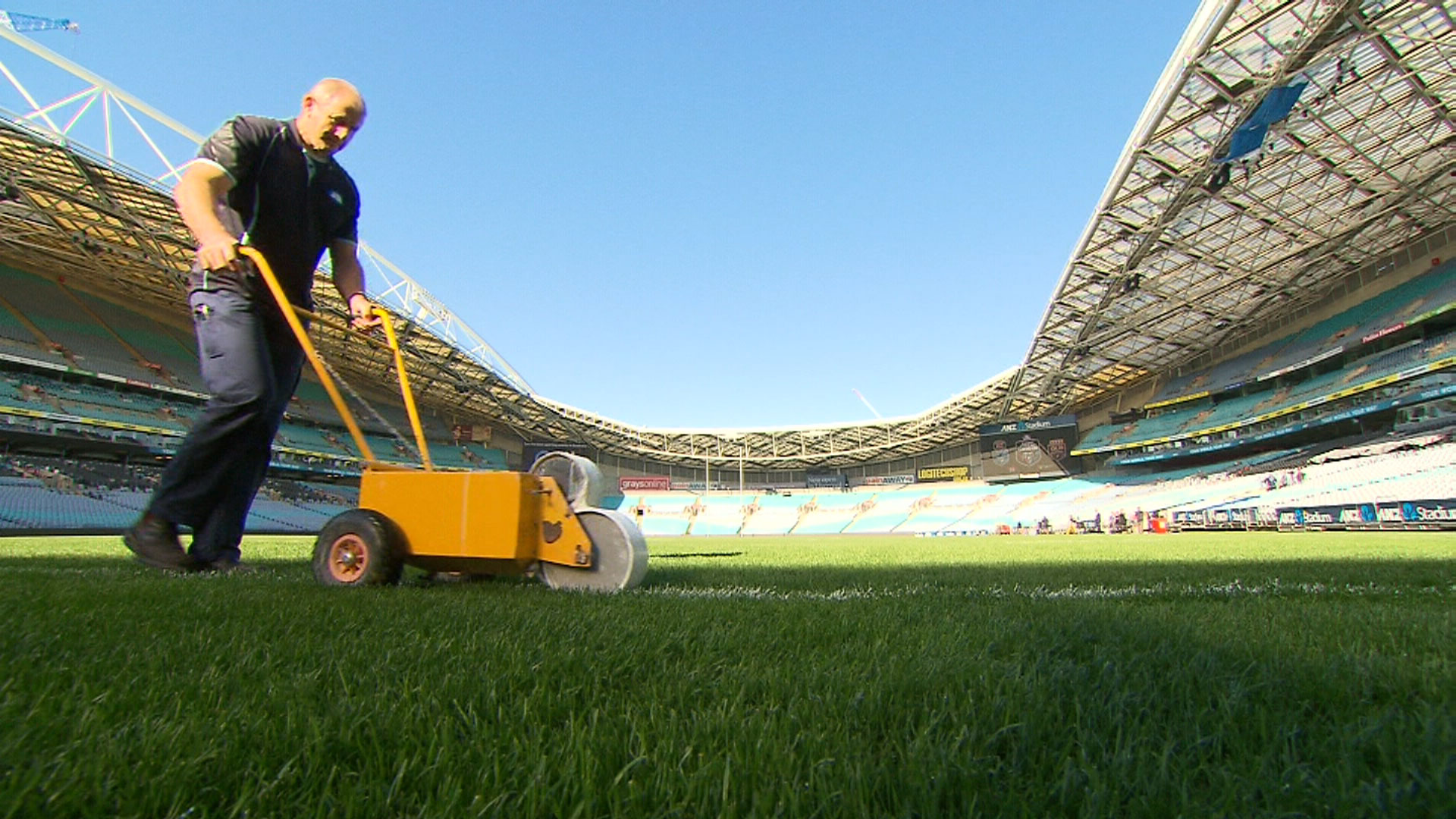 Preparing the field for the game. (9NEWS)