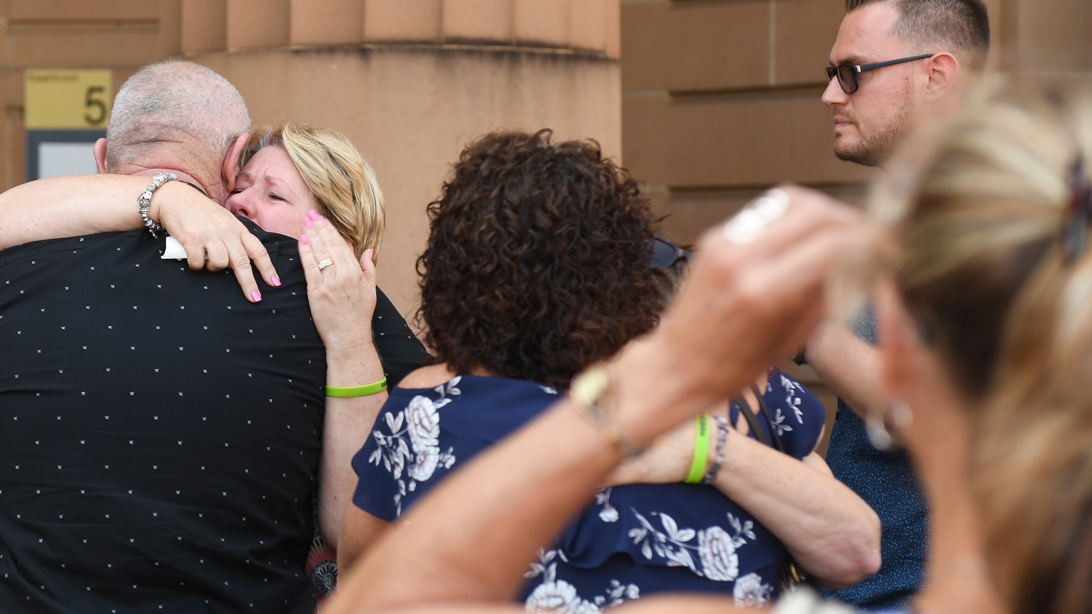 Family and friends of Greg Gibbins leaving the Supreme Court in Sydney today. (AAP)