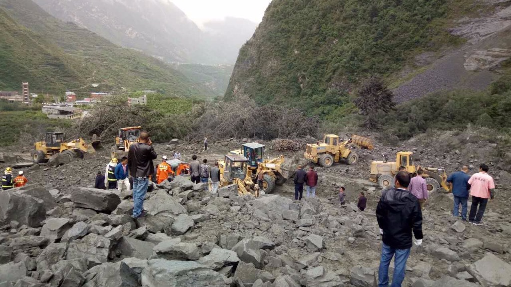 The landslide hit the village of Xinmo about 8am AEST. (AFP)