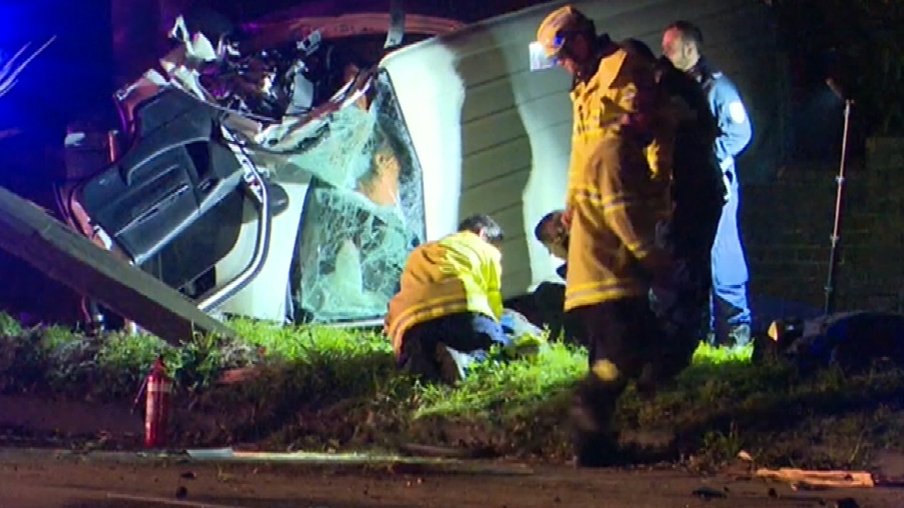 The driver lost control of his van and ploughed into a power pole, flipping the vehicle on its side. (9NEWS)