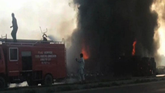 A lorry transporting oil caught fire and burst into flames on a highway in Pakistan. (Radio Pakistan)