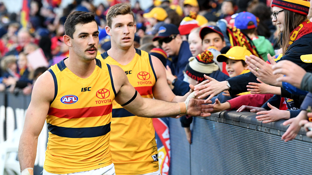 Adelaide down dogged Carlton in AFL
