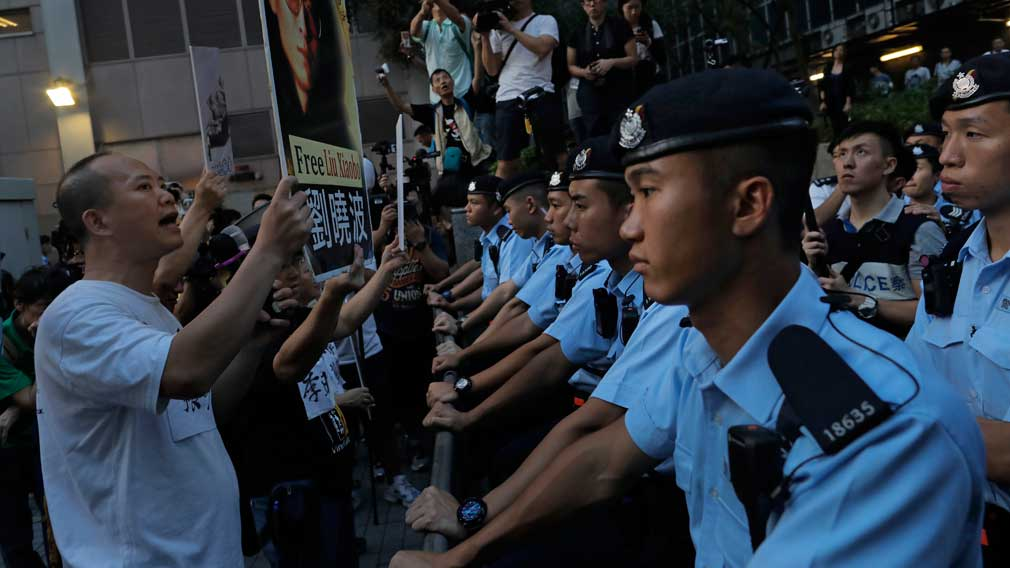 China's Xi warns protesters not to cross 'red line' in Hong Kong