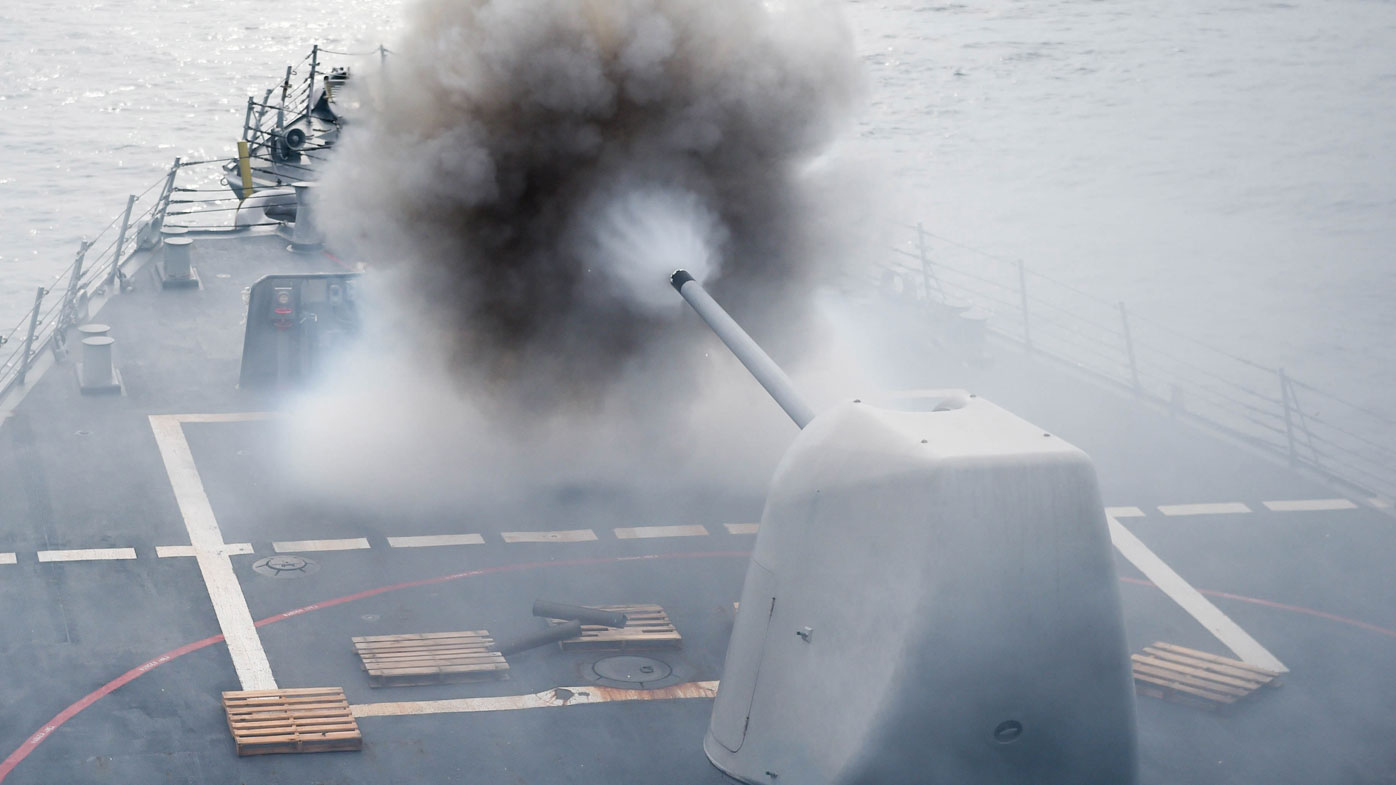 the Arleigh Burke-class guided-missile destroyer USS Stethem (DDG 63)as it conducts a firing exercise of the MK 45/5-inch lightweight gun at a surface target (AFP).
