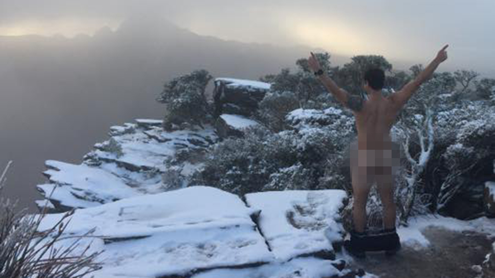 A little cheeky: two mates took photos after a rare snowfall in Bluff Knoll in WA. (Facebook)