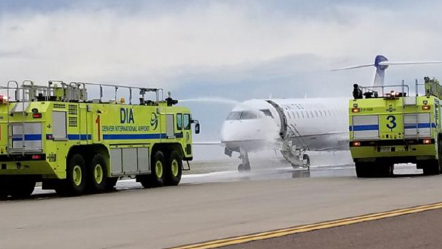 United jet catches on fire at Denver airport