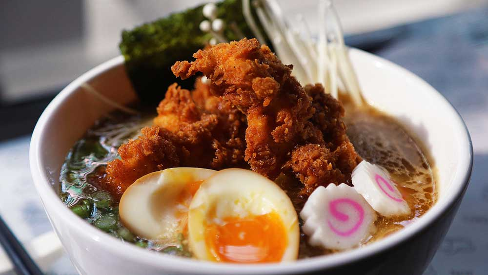 Butter's ultimate chicken ramen topped with extra fried chicken