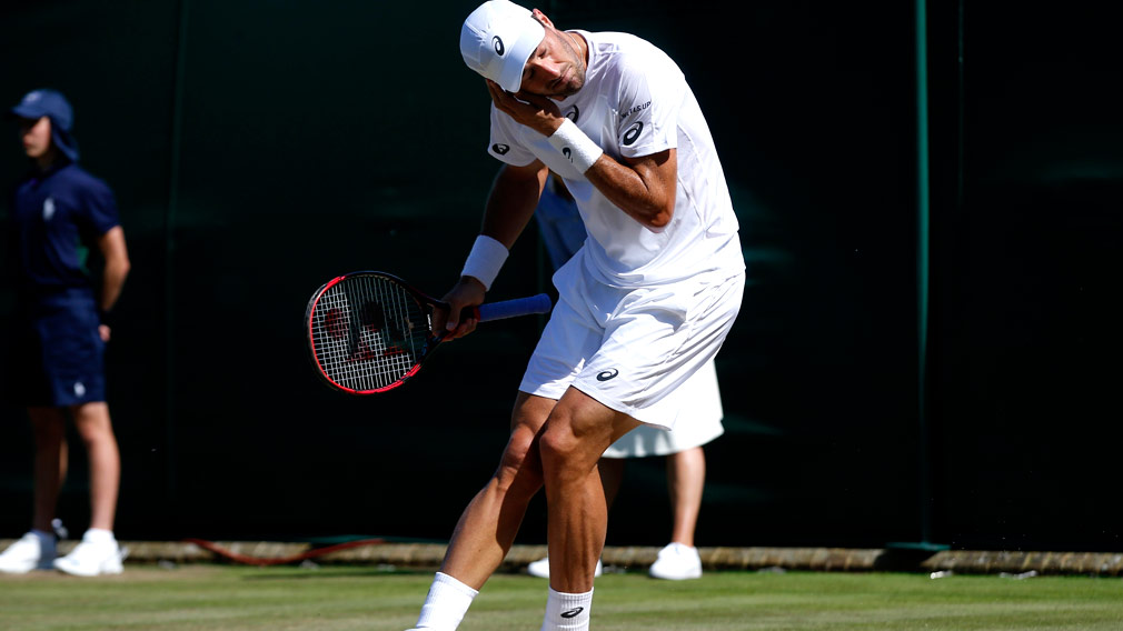Steve Johnson of the United States gestures to get rid of flying ants during the Men's Singles Match against Moldova's Radu Albot. (AAP)