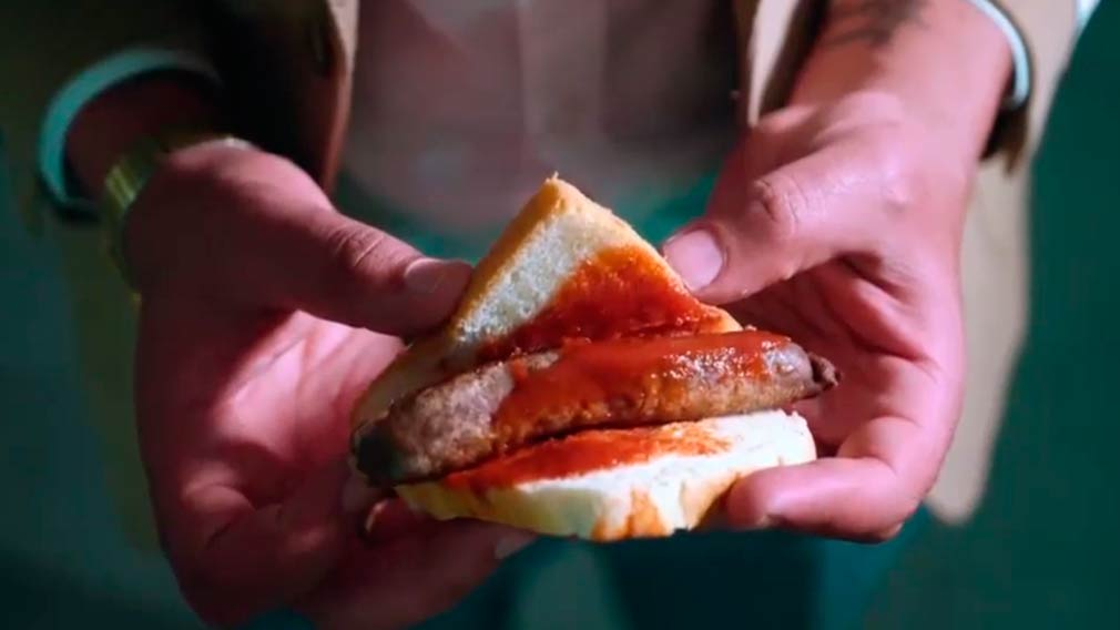 The add pokes fun at the humble sausage sandwich.