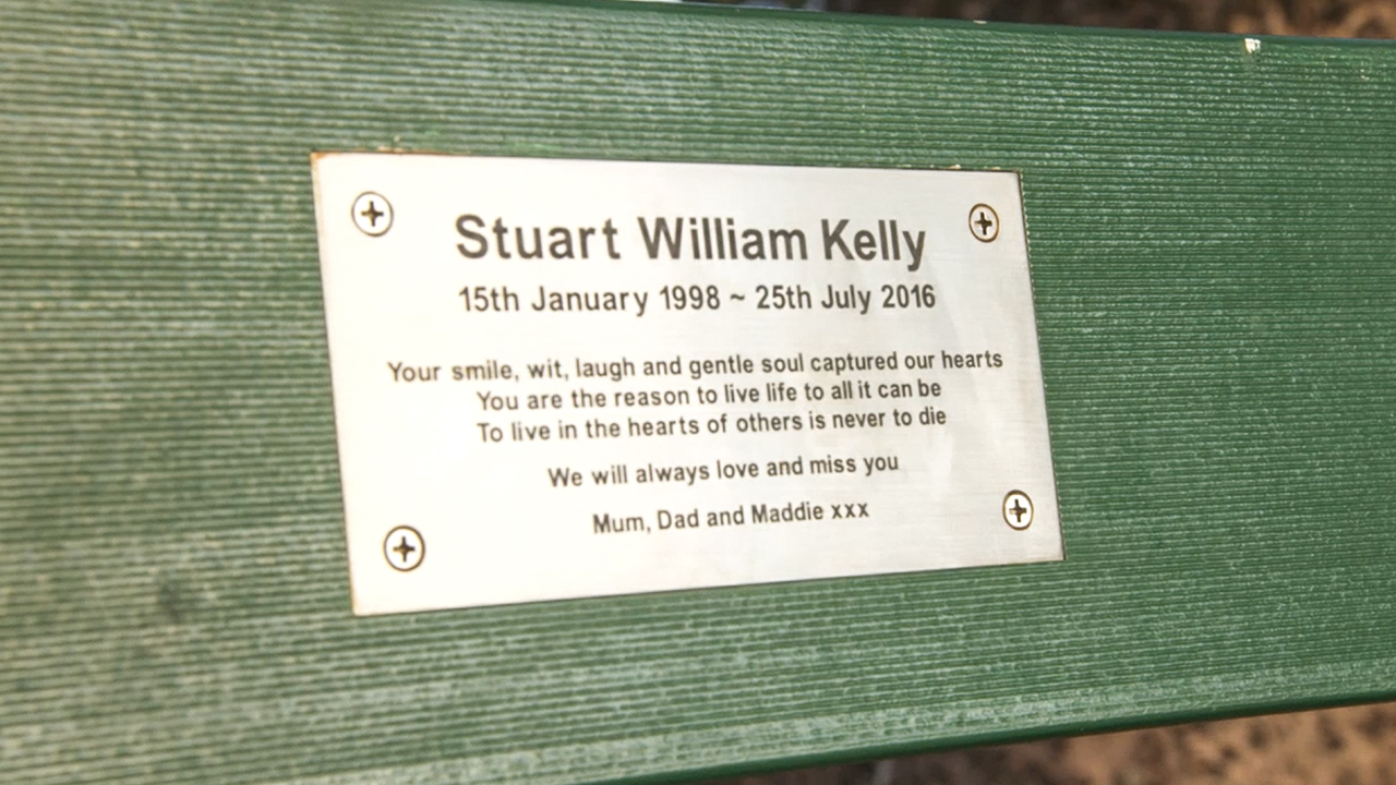 A memorial plaque for Stuart Kelly. (60 Minutes)