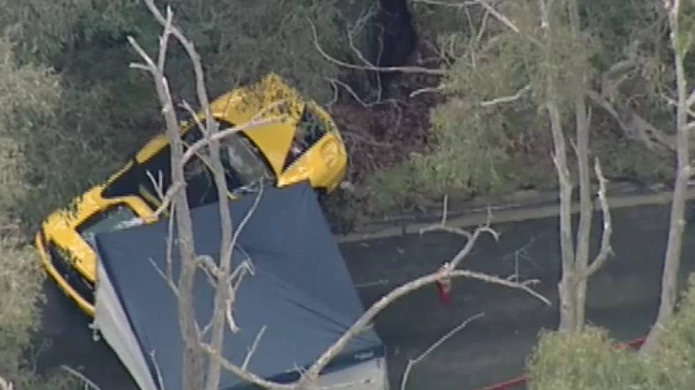 A woman has died in a crash involving a Ferrari this afternoon. (9NEWS)