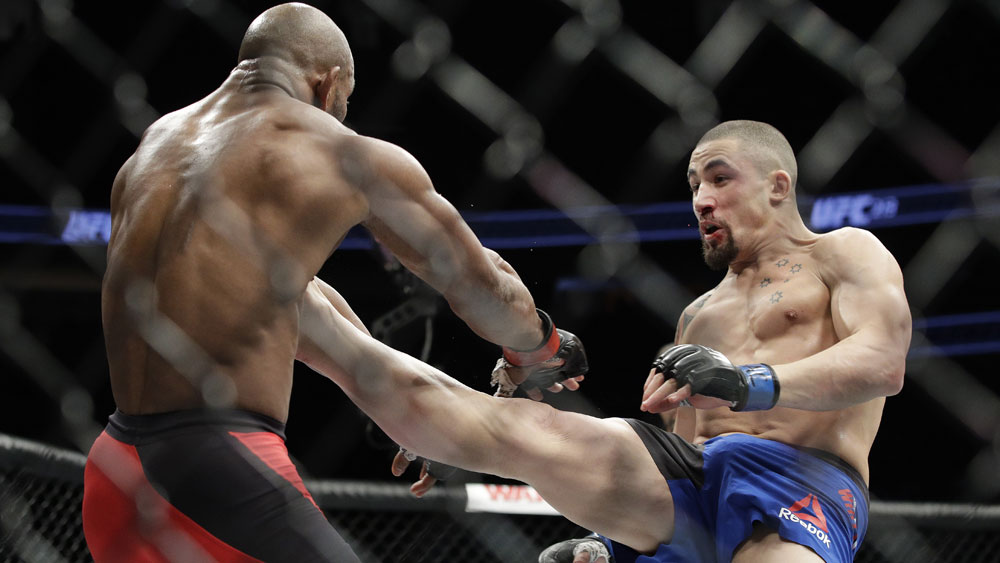 Australia's Robert Whittaker wins UFC interim middleweight against Cuba's Yoel Romero