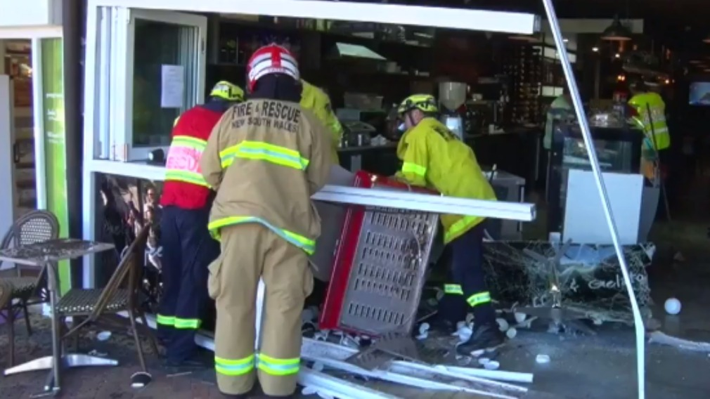 Fire crews assisted cafe staff with the clean up this afternoon. (9NEWS)