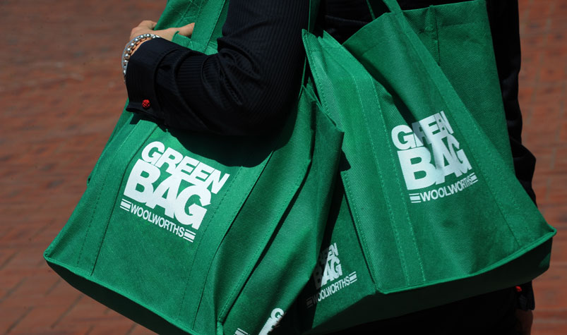 Woolworths and Coles to phase out plastic bags over the next 12 months